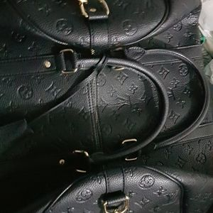 Louis Vuitton Keepal Bandouliere Carry Bag